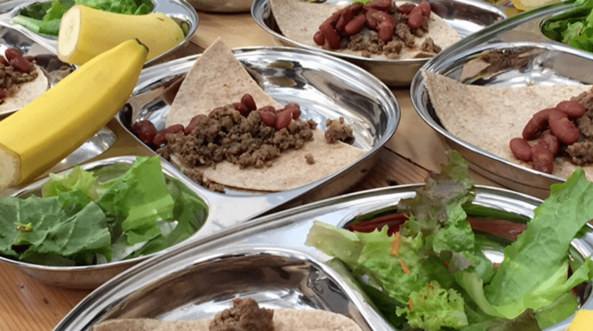 plate of banana, ground meat, and lettuce
