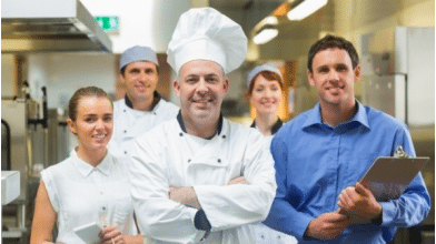 image of chef with a team behind him