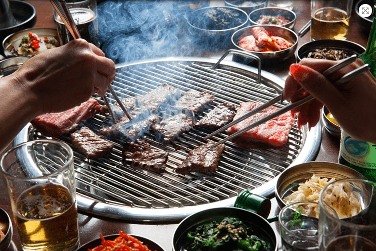 Korean BBQ image with chop sticks